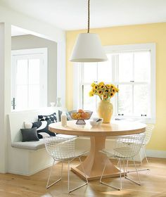 It's hard to resist this kitchen accent in Benjamin Moore's Hawthorne Yellow. It works well with all of the white trim, ceilings and the white banquette and chairs. And the lemons and sunflowers! Photo: courtesy of Benjamin Moore. Yellow Paint Colors, Best Paint Colors, Kitchen Paint Colors, Room Paint Colors, Yellow Painting, Paint Colors For Home, Yellow Kitchen Walls, Yellow Walls Living Room, Yellow Painted Rooms