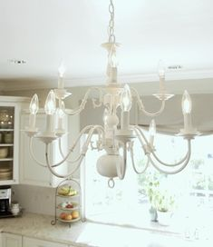 Picked up a brass chandelier that looks just like this one. Can't wait to make it pretty again!