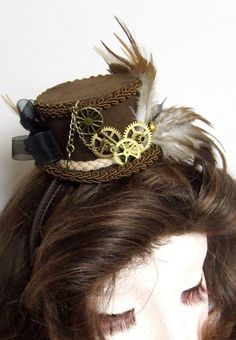 Steampunk Hair FASCINATOR mini hat headress Feathers and watch gears. $75.00, via Etsy.