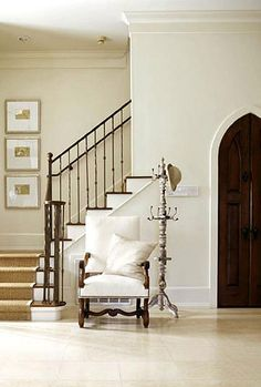 This foyer with the gothic door and staircase reminds me of a throne room.