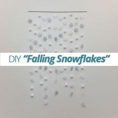 The holiday season is the perfect time to create in your home! Bring some falling snowflakes into your home this season with a lovely DIY falling snowflake garland. This simple project will dress up any room, giving your home a winter wonderland feel. Try this DIY project and bring a little festivity into your home for holidays! Supplies Thin wooden rod Fishing line (can be purchased at craft stores) Glue gun Various scrapbooking papers Metal clips Styrofoam balls Silver or champagne…
