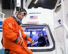 NASA astronaut Randy Bresnik prepares to enter Boeing's CST-100 spacecraft for a fit check evaluation at the company's Houston Product Support Center in this undated image. NASA will partner with Boeing and SpaceX to build commercially owned and operated 'space taxis' to fly astronauts to the International Space Station, ending U.S. dependence on Russia for rides, officials said on Tuesday.    REUTERS-NASA-Handout via Reuters