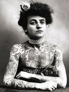 vintagegal:    Maud Wagner, the first known female tattooist in the U.S., 1911. In 1907, she traded a date with her husband-to-be for tattoo lessons.