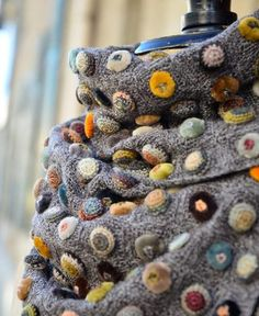 Sophie Digard / echape wool biscuit pop minus (3502 / MR / SWALEDALE / VOLC) by Sophie Digard   petiteparis translate website http://petiteparis.net/products/sophie-digard-echape-wool-biscuit-pop-minus-3502-mr-swaledale-volc w/google translation, but looks like you can only buy the scarf not buy a pattern.