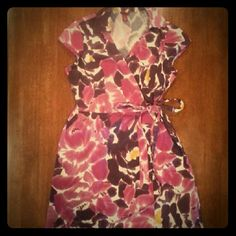 Watercolor floral wrap dress Watercolor floral in hues of plum and magenta, with a hint of yellow. Collared, cap sleeves, wraparound with fabric belt at waist. Medium thickness cotton. Merona Dresses