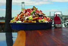 Cantina Marina nachos - Let's get one thing straight: Cantina Marina's nachos are good, but the real pull here is the awesome view. The open air, dockside restaurant is best known for its margarita selection, but there's not much that can beat gazing out at sailboats on the Washington Channel while pounding down an enormous platter of chips, chili, shrimp, steak, Andouille sausage, queso, pico de gallo, crema, avocado, and jalapeños.