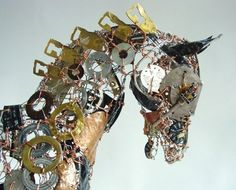 http://www.planetcustodian.com/wp-content/uploads/2012/06/Recycled-Running-Horse-Sculpture.jpg