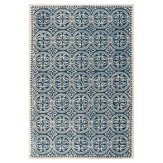Adorned with intricate medallions, this hand-tufted wool rug brings elegant appeal to your floors.   Product: RugCon...