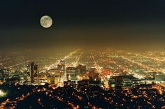 Full Moon watches over the city.
