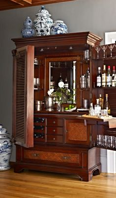 From the moment you first lay eyes on our Havana Barmoire, you know it will be a family heirloom for generations. Closed, it is a coastal-inspired armoire with a beautiful faded mahogany finish, unique louvered doors, and custom-made antiqued brass hardware. But pull open the doors and it instantly sparkles, fitted to serve and store anything a bar might need.