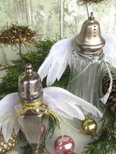 Turn vintage salt & pepper shakers into Angels by attaching feathered wings...