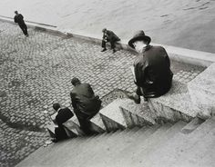 Ilse Bing, 'Three men on steps by the Seine', 1931. Museum no. E.3032-2004, © Estate of Ilse Bing Wolff