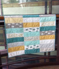 Baby quilt bliss- love this design, but I also love the colors for our living room!