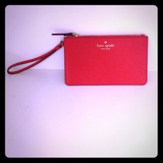 "Kate spade ""slim bee"" wristlet! Perfect wristlet for a night out or to use in your handbag as a wallet.  Cross hatched saffiano leather is perfect for securing your small essentials! Woven signature dot lining, rear exterior pocket, zip top.  Color is cherry liquor kate spade Bags Clutches & Wristlets"