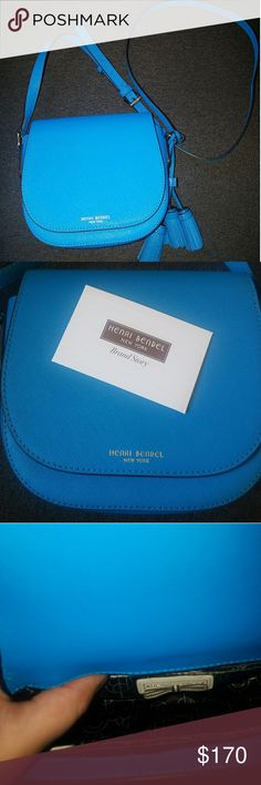 Henri bendel cross body bag Teal Henri bendel small cross body bag, has two pockets inside and a large pocket on the back. It's in mint condition only used once. henri bendel Bags Crossbody Bags