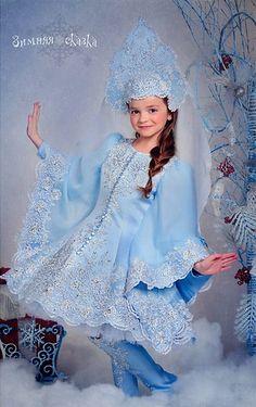 Pretty Russian girl in kokoshnik, traditional headdress.