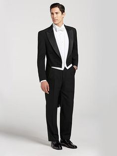 Finally, a full dress tailcoat for the modern gentleman. With a satin-faced peak lapel, pair it with pleated pants to complete your distinguished look. Black Tuxedo Wedding, Black Tuxedo Suit, Groom Tuxedo, Tuxedo Dress, Tuxedo For Men, Costume Smoking, Tuxedo With Tails, Wedding Suits, Wedding Tuxedos