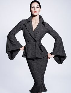 Loving the sleeves. Elegant and modern and a evident homage to a 1951 styled suit done by California designer, Lilli Ann.