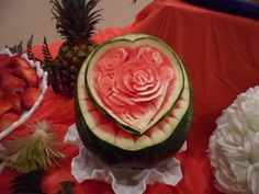 Watermelon carving of a heart and roses for a wedding shower. See other ideas at http://www.vegetablefruitcarving.com/blog/vegetable-and-fruit-arrangement-ideas/#