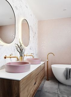 Blush tones // bathroom // oval double mirrors // top sitting double sinks // penny tile wall // gold bathroom hardware