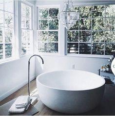 Round bathtub. Crystal clear chandelier.