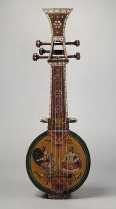 Oriental guitar family type instrument. Sursanga, 19th circa, made from Indian wood, pearl and ivory.