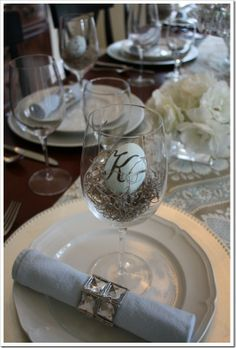 Easter - Placecards using an egg and stick-on initial - on their own nest inside of a wine glass!