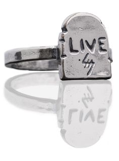 """THE LIVE RING FROM HELTER SKELTER METALHEADS. STANDARD RING SIZES APPLY. THIN BAND WITH A GRAVE INSCRIBED WITH """"LIVE"""". SILVER PLATED WHITE BRONZE. MADE IN THE USA."""
