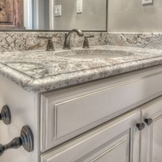 Beau Cold Spring Granite With White Cabinets