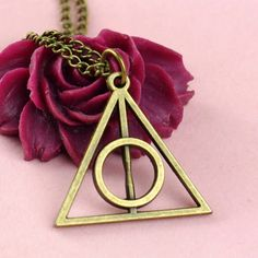 series harry potter and the Deathly Hallows bronze or silver with chain by frenciudesign on Etsy https://www.etsy.com/listing/200327210/series-harry-potter-and-the-deathly