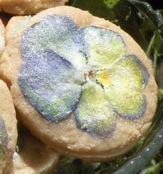 Using edible flowers from your organic garden to bake with. Lavender cookie with sugared pansy.