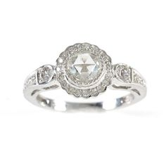 This gorgeous antique-inspired engagement ring features a rose cut center diamond surrounded by a floral shape of beautiful pave diamonds on a decorated band.  at Greenwich Jewelers