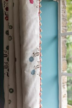 Curtains is 'Yasmina' by Penny Morrison with a George Spencer 'Fan Edge Trim 403/03' . Walls in Stone Blue by Farrow and Ball