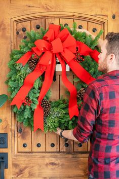 It's not Christmas without a fresh Christmas wreath on your door! Send the spirit of the season to someone special with this classic piece of holiday decor. The 24-inch wreath is composed of fragrant noble fir with touches of juniper and red berries, and is hand delivered by a local florist to ensure maximum freshness. This 24-inch noble fir wreath is accented with juniper, red berries and pinecones and finished with a full red velvet bow.