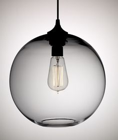 Solitaire Pendant by Jeremy Pyles of Niche (available in a range of colors); $475 at Y Lighting.