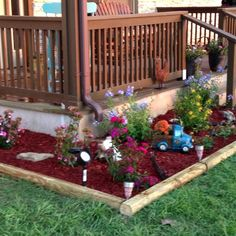 Inspiration for next year.  Flower beds around 2 sides of our deck!