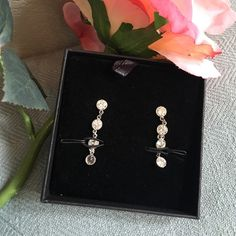 Crystal Strand Dangle Earrings These gorgeous stud earrings feature four crystal rounds each. Never been worn. Jewelry Earrings