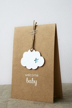 Such sweetness!  This fluffy cloud simply hung on a cord with staples speaks volumes to welcome your little one!  White embossing powder adds a bit of sparkle to this handmade baby card.