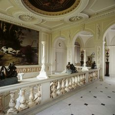 The top of the Upper Marble Staircase at Kingston Lacy. The balustrade is of alabaster capped with Biancone marble. The candelabra are also of Biancone, and the bronzes are probably eighteenth-century copies of Michelangelo's Times of Day in the Medici Chapel of S. Lorenzo in Florence