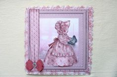 pink sunbonnet sue on Craftsuprint designed by Cynthia Berridge - made by Rosina Walker - I took some pretty pink backing paper ithen with my punch,punched along the edge and cut the strip of,i did this four times to make a frame for this image,i printedthis image onto decoupage paper,then stuck the punched frame onto the four sides,then mounted it to a large square card .and built up the front,i added some clear gems to the bow. - Now available for download!