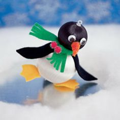 This adorable penguin is just one of several animals your kids can craft with just ball ornaments and clay