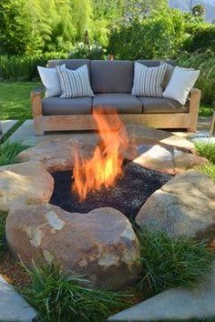 Patio Fire Pit in the backyard of this Santa Barbara Modern Ranch home. Contemporary use of large boulders and dark fireglass to enhance this fire feature. San Luis Obispo - Jeffrey Gordon Smith Landscape Architecture