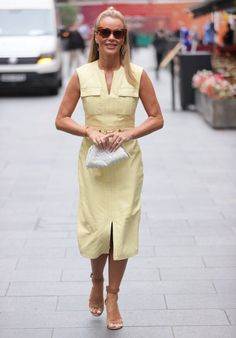 Amanda Holden wearing a yellow sleeveless dress and ankle strap sandals | For more style inspiration visit 40plusstyle.com
