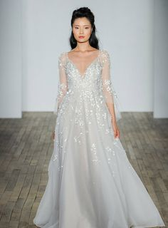 """Check out when #WilkieGotPaiged at this season's New York Bridal Fashion Week with designer Hayley Paige! Here, we see her """"Guinevere"""" design."""