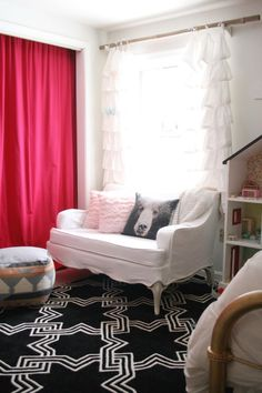 Eclectic girl's room in pink, black, and white; adorable white denim slipcovered settee, dollhouse book shelf, pouf, and bamboo curtain rod