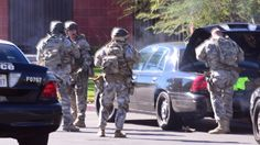 "Police were searching for up to three suspects Wednesday in connection with a deadly mass shooting in San Bernardino, California, where up to 14 people were reported killed and as many as 14 more were wounded.  ""The suspects have fled,"" said San Bernardino Police Chief Jarrod Burguan. ""We don't yet have a motive."""