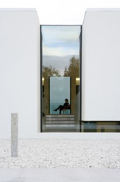 lighting /windows/styling - Doorway hidden in volcanic stone wall of house by PK Arkitektar Architecture Design, Minimal Architecture, Residential Architecture, Amazing Architecture, Contemporary Architecture, Contemporary Sofa, Farmhouse Contemporary, Melbourne Architecture, Installation Architecture