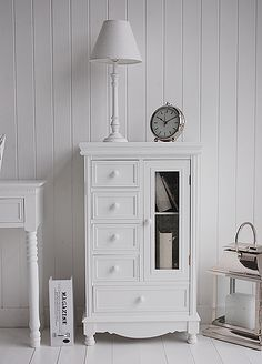 White hall furniture, a storage cabinet with drawers for hallway