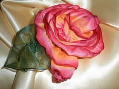 Ribbon Rose tutorial - fabric ribbons attached to tulle and sewn/glued to anything as an embellishment. I need to get out all those roses I made so long ago.