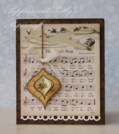from Annabelle Stamps blog--love the page from an old songbook for background